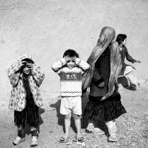 Children in an alley of clay houses. A small village without name, in the desert zones next to Isfahan- Iran 2013