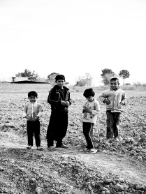 Children in uncultivated fields. Desert zones close to Isfahan- Iran 2013