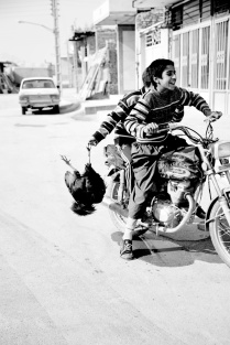 The children on motorcycles bring the lunch home. Ici, a small village next to the city of Share Rez Iran. 2013