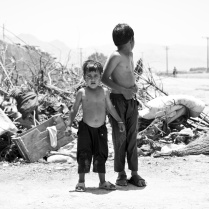 The children play in the trash. Ici, a small village next to the city of Share Rez - Iran. 2013